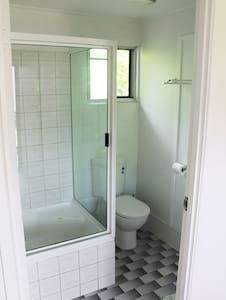 Please note that there are no steps to enter the bathroom, however there is a step into the shower itself, which is over a small tub. This type of shower is known as a shub.