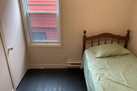This picture shows the space between closet and bed
