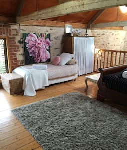 There are two beds in spacious loft room one both with lots of room to access . The queen bed a metre suave on the far side and several metres space on the near side to access. The single bed has several metres space along one side to access easily