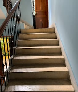 This is the staircase to lead to the room on mezzanine floor and then the bedroom is wide enough for any person to move around with ample space