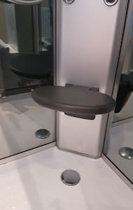 Fold chair in shower cubicle
