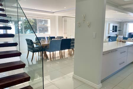 The apartment is open plan, as you enter the front door, there is an opening into the kitchen. Alternatively, guests can walk around the kitchen island and into the large kitchen space.