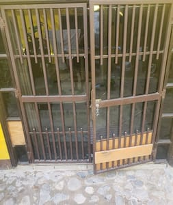 French doors;  door jamb is only uneaven ground.. approximately 2 inches.