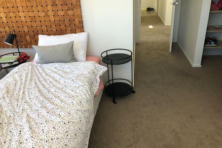 Flat hallway to master bedroom.