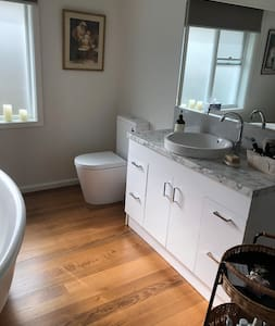 No steps into the ensuite bathroom, plenty of room to access basin and toilet