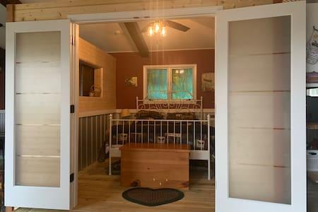The bedroom doorway is very wide and open for easy access.
