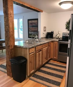 Open concept between the Kitchen and Family/Sitting/Dining Rooms.