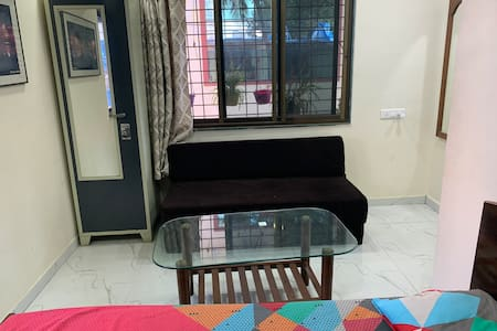 Double bed and sofacum bed have a good distance.
