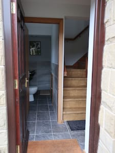 Access to toilet and shower is flat and on the ground floor, but the rest of the apartment is up stairs