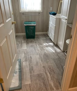 It shows 36 inch doorway leading to white storage area, sit down stool, mirror for makeup! The sink is next! The other side is the small step in shower and the commode is in a separate room next to the shower!