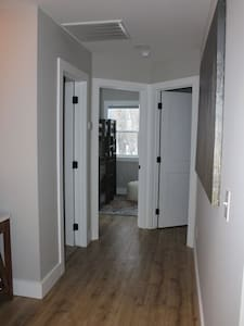 This photo shows the entrance to both bedrooms. There are no steps required for entry.