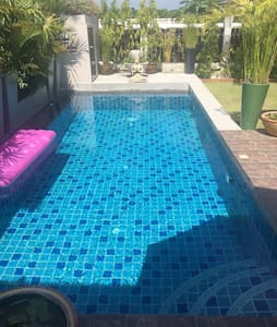 Steps into the pool for easy access.