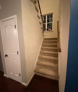 Stairs to upstairs bedroom