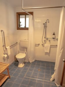 Bathroom is wheel chair friendly and we have a shower seat available on request