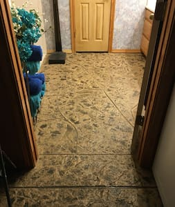 Flat, wide entrance into the bathroom.