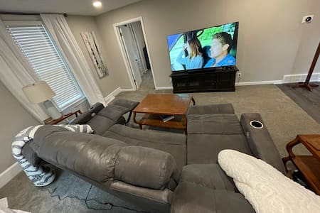 Main level bedroom is located off the TV room.