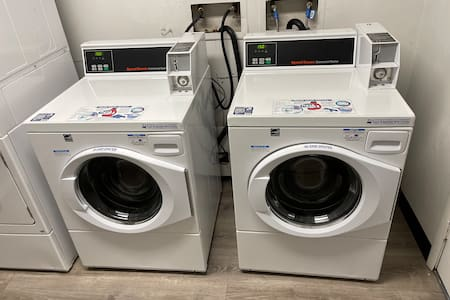 Washer and dryer on first floor, in same building. Cost $1.50 each per load.