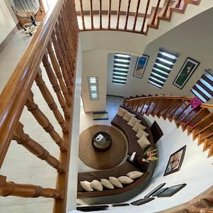 Wooden stairs leading to the private bedrooms