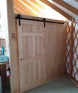"""Bathroom has wide """"barndoor"""" type door"""