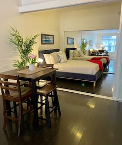 Wide entrance to the bedroom when the frosted sliding glass doors are adjusted.
