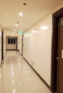 This is the hallway going to the condo unit, after the guest takes the elevator to go to the floor where the condo unit is located. It's accessible and safe for guests including elderly and handicapped.