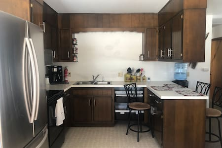 Kitchen is open to living room and dining area which has a table that seats 4. The kitchen has a breakfast bar/counter with 3 bar stools