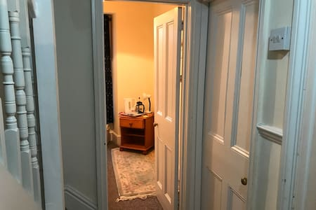 The room is directly opposite the bathroom