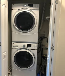 Laundry inside the unit.  Full size stacked washer and dryer