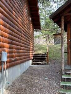 A short walk of 60' on smooth gravel to the bathroom/laundry. 5 wood steps to enter.