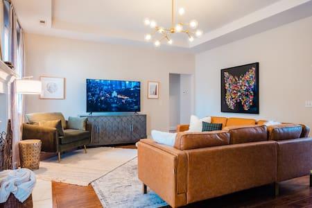 Wide doorway leads from living room to bedrooms