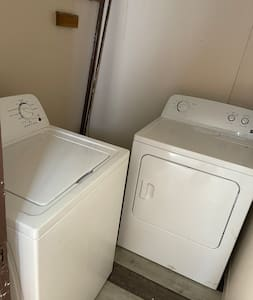 No steps nor stairs for laundry room. Laundry room is attached to kitchen. Step right into laundry room from kitchen.