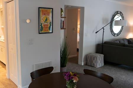 Open doorway into bedroom/bathroom hallway