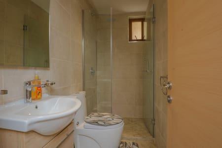 Wide doorway to the bathroom