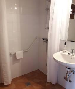Pevné držadlá v sprche