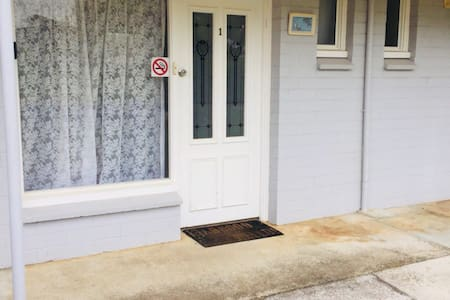 Ease of access to the front door with downstairs bedroom and separate apartment stair free