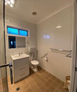 Hand rail next to toilet.