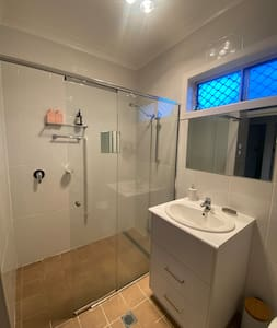 The entire house is level with no steps.  The bathroom has a grab rail in shower and next to toilet.  The shower walk-in style and wide swing door allows access for wheelchair or shower seat.
