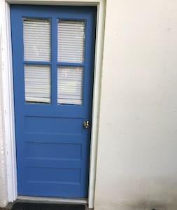 """This is the door to your unit.The queen bed/sleeping area is in the """"en suite"""" area."""