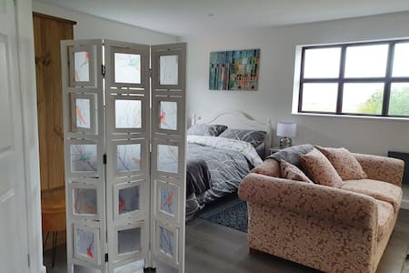 The entrance to the bedroom area has a screen room divider that can be folded and removed if needed