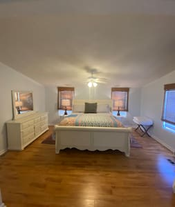 Huge Master bedroom with own bathroom, closet, double sinks, shower, tub.