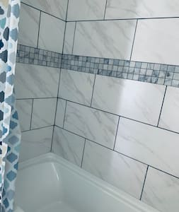 A full size tub and shower