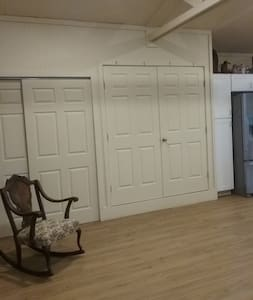 The murphy bed is behind these doors. the entire floor of this unit is flat with 36 inch wide doors at all access points.