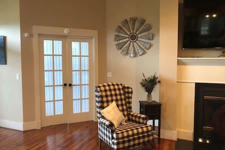 Double wide doors into bedroom allow plenty of room for entry.