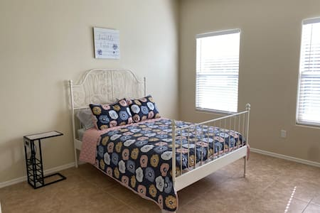 This is the bedroom 2 which is on the bottom floor of our 2 story townhouse and you do no need to pass any steps