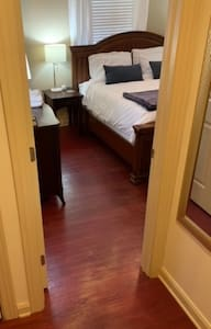 Entrance to the king bedroom is all flat, hardwood surface.