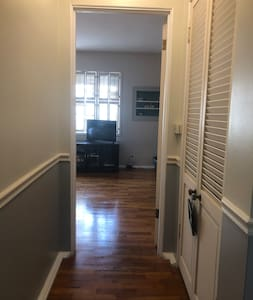 Entrance from hallway to first bedroom.