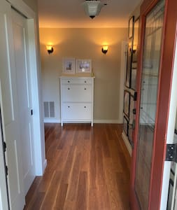 The entryway to the bedroom is flat and features vinyl plank flooring.
