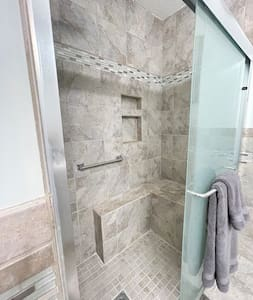 Fixed grab bar in shower.