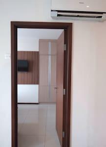 Door to bedroom, from living room.