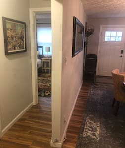 Image shows front door and guest room door. No stairs to access guest room.